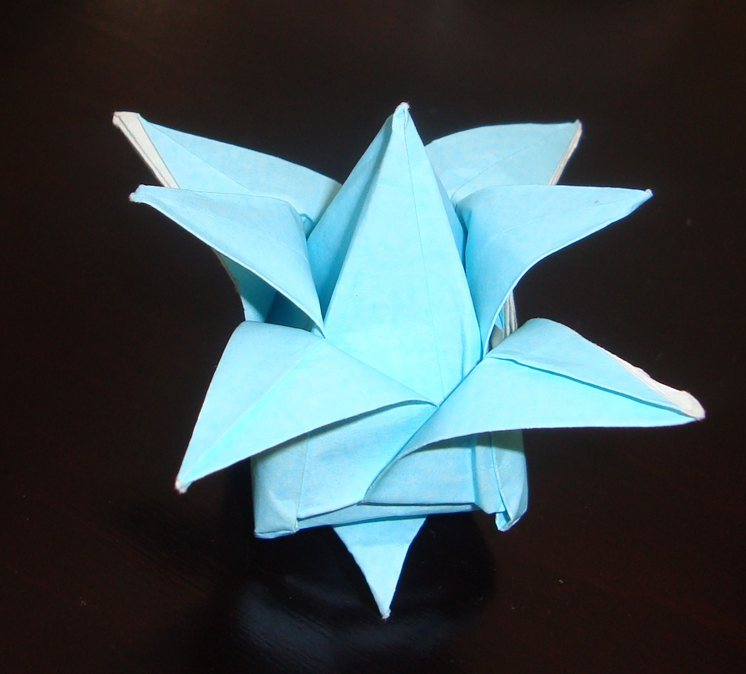 Avraham aizenbud other 2my origami flower this origami is based on a classical origami of 4 petal flower we start with folding the corners to the center later we can use them in order to make mightylinksfo
